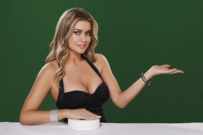 Carmen Electra in a black dress promoting  Pokerist.com