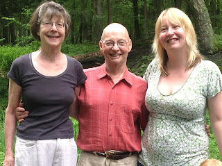 Photo of Anne Flitcraft, Evan Stark and Nancy Lombard in the woods near their home