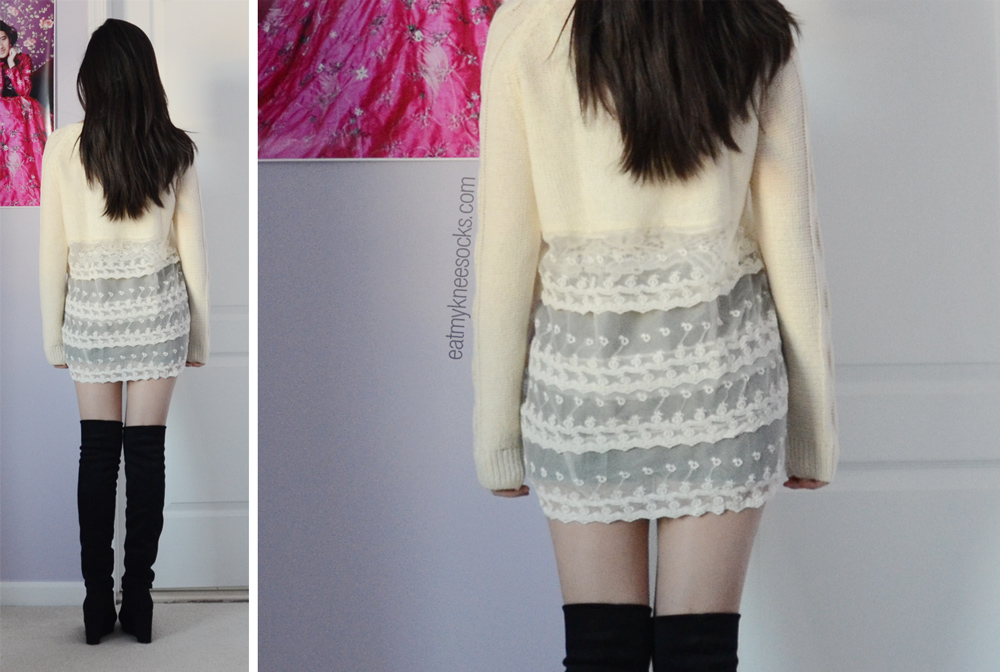 The details of the ruffled, tiered lace/mesh hem of the baggy cream sweater from Romwe.