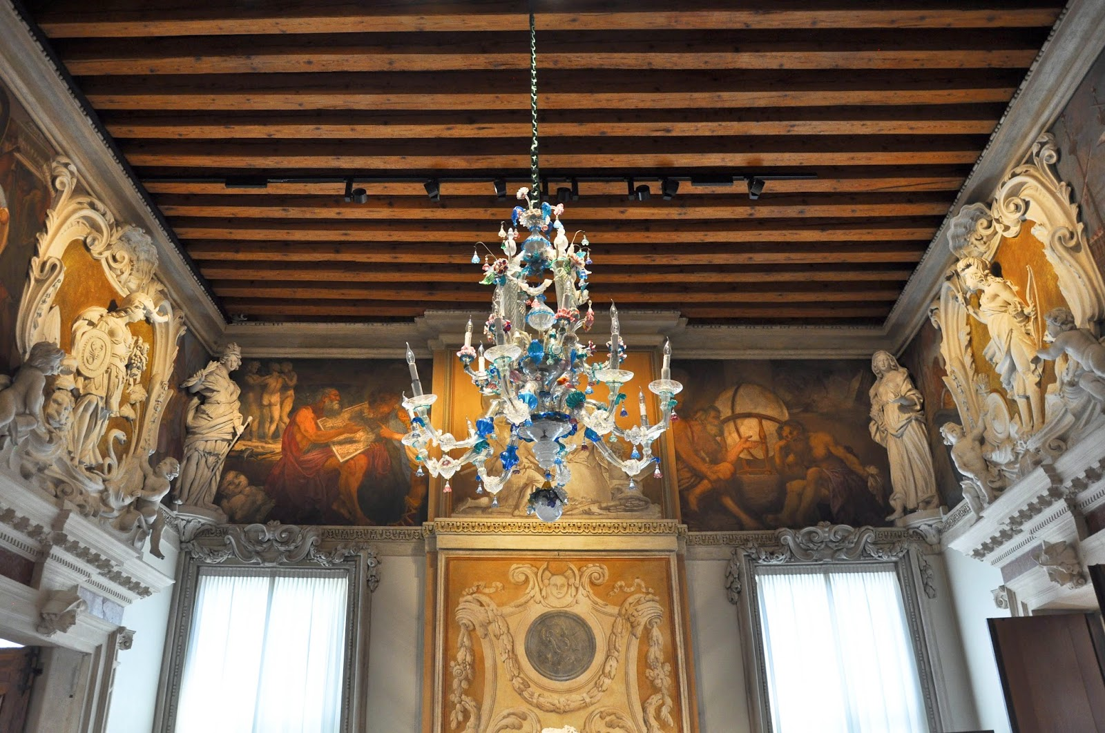 Murano glass chandelier and lavish bas-relives and frescos, Gallerie D'Italia in Palazzo Leoni Montanari, Vicenza, Italy