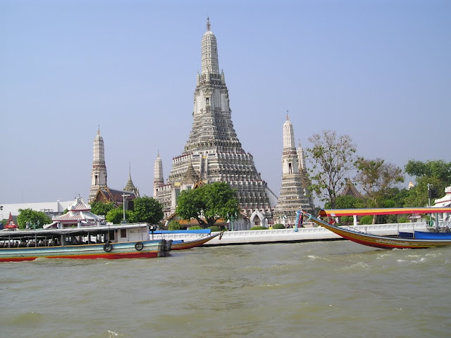 Wat Arun Temple can be seen along Chao Phraya River in Bangkok, Thailand