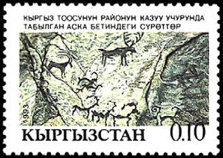 Pinturas prehistóricas. Sello postal de Kiguistán del año 1993 que representa pinturas rupestres con dibujos de ciervos e íbices