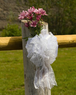 Decorate a post with lace bow and flowers