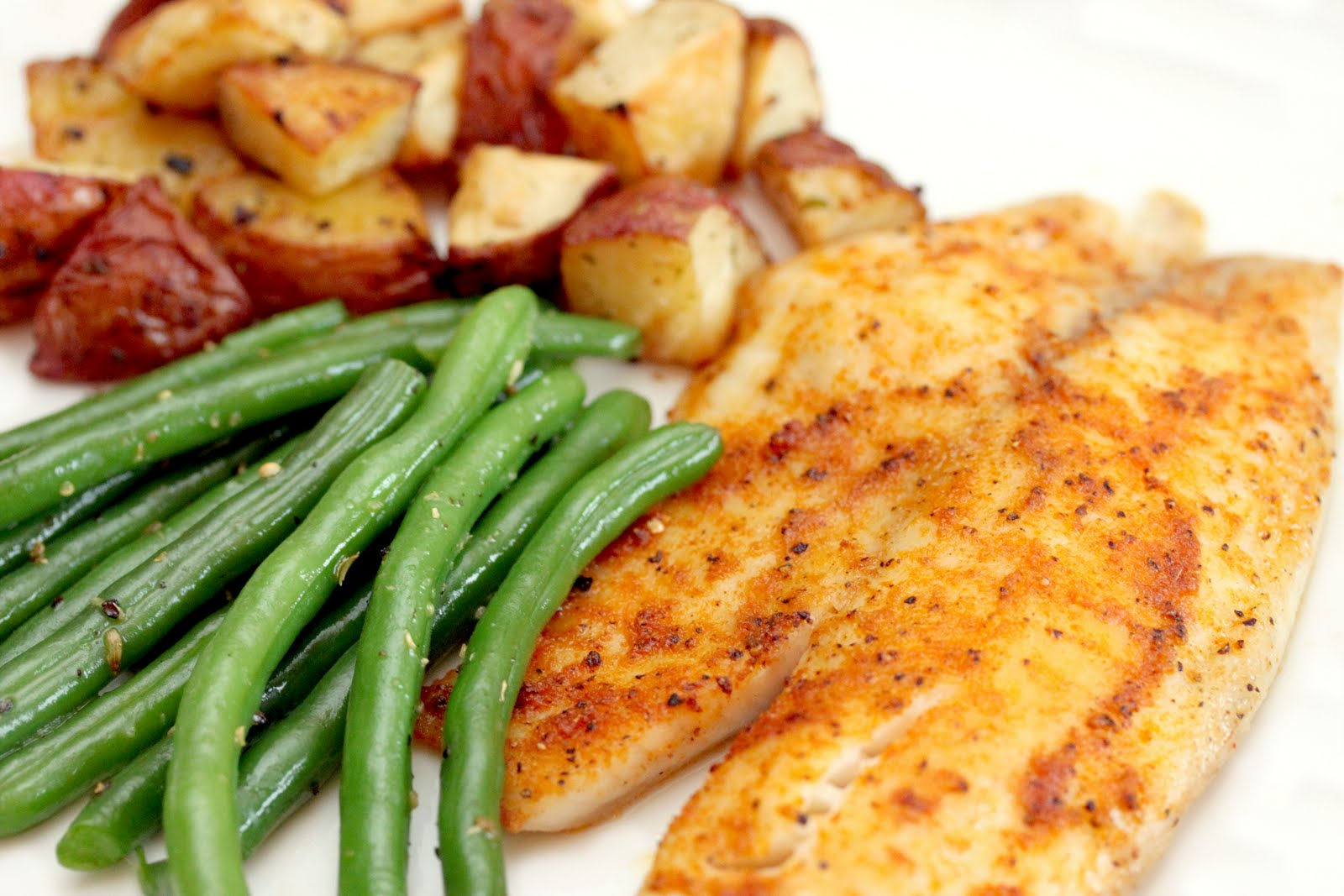 gingersnaps: spicy blackened tilapia with garlic roasted potatoes