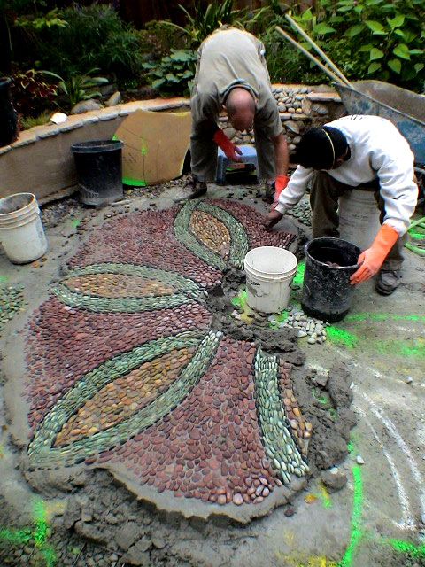 Stone art blog jeffrey bale 39 s mosaic pilgrimage a labour for How to build a river rock patio