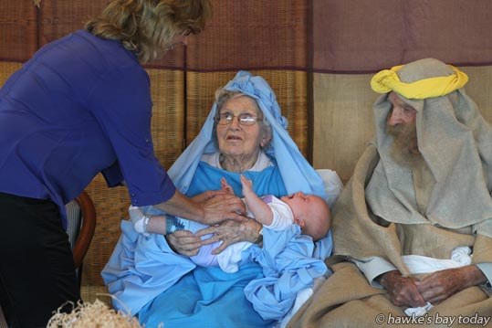 L-R: Michelle Armstrong, diversional therapist, Brenda Kyle (Mary), Isla Wilson, Bay View (Baby Jesus), Derek Wedd (Joseph) - Residents at Waiapu House, Havelock North, performing a nativity play. photograph