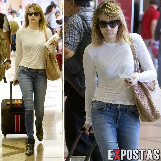 Emma-Roberts-e sua-blusa-branca-transparente-no-aeroporto-LAX