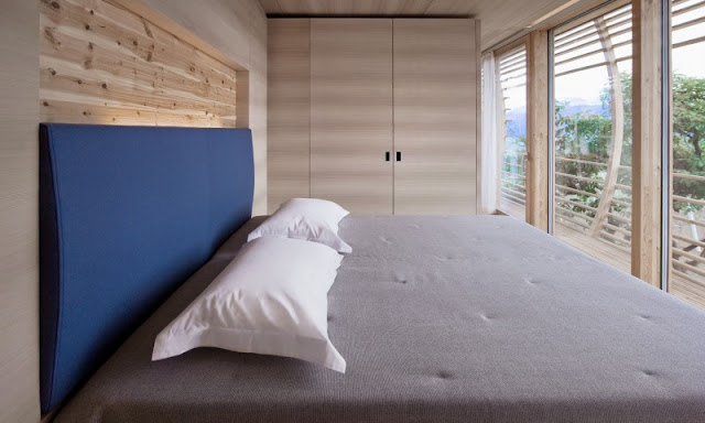 Pillows Brown Bed Linen and Soft Brown Cupboard Made from Wooden Material