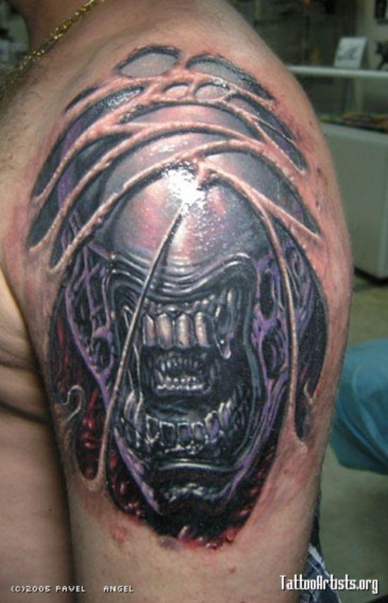 alien creature tattoo on the shoulder biomech tattoo alien creature