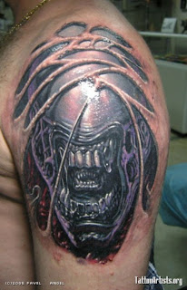 alien creature tattoo on the shoulder