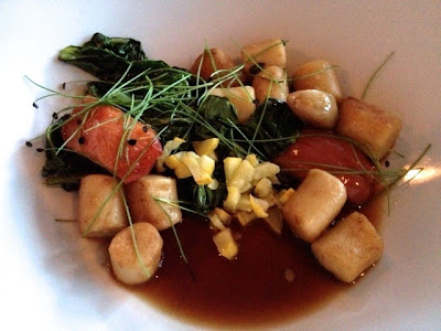 Gnocchi with black garlic broth