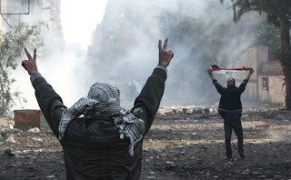 Egyptian protesters flash the V-sign for victory during clashes