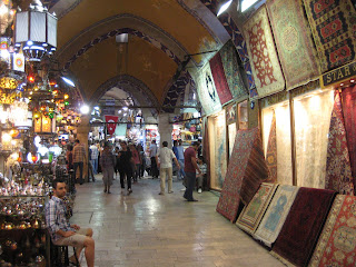 Carpets and hanging lamps inside the maze of the Grand Bazaar.