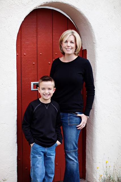 Beautiful Tucson woman stands with son in doorway Downtown Tucson