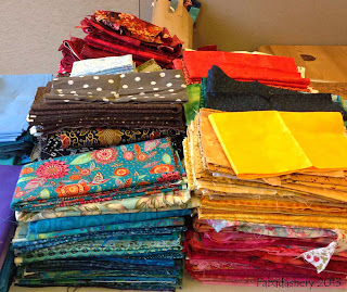 Quilt Fabric sorted into colour families