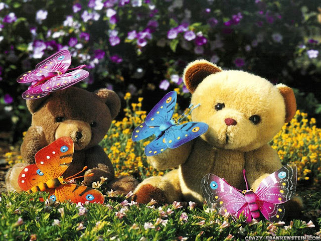two teddy bears having a picnic in the garden with bright butterflies