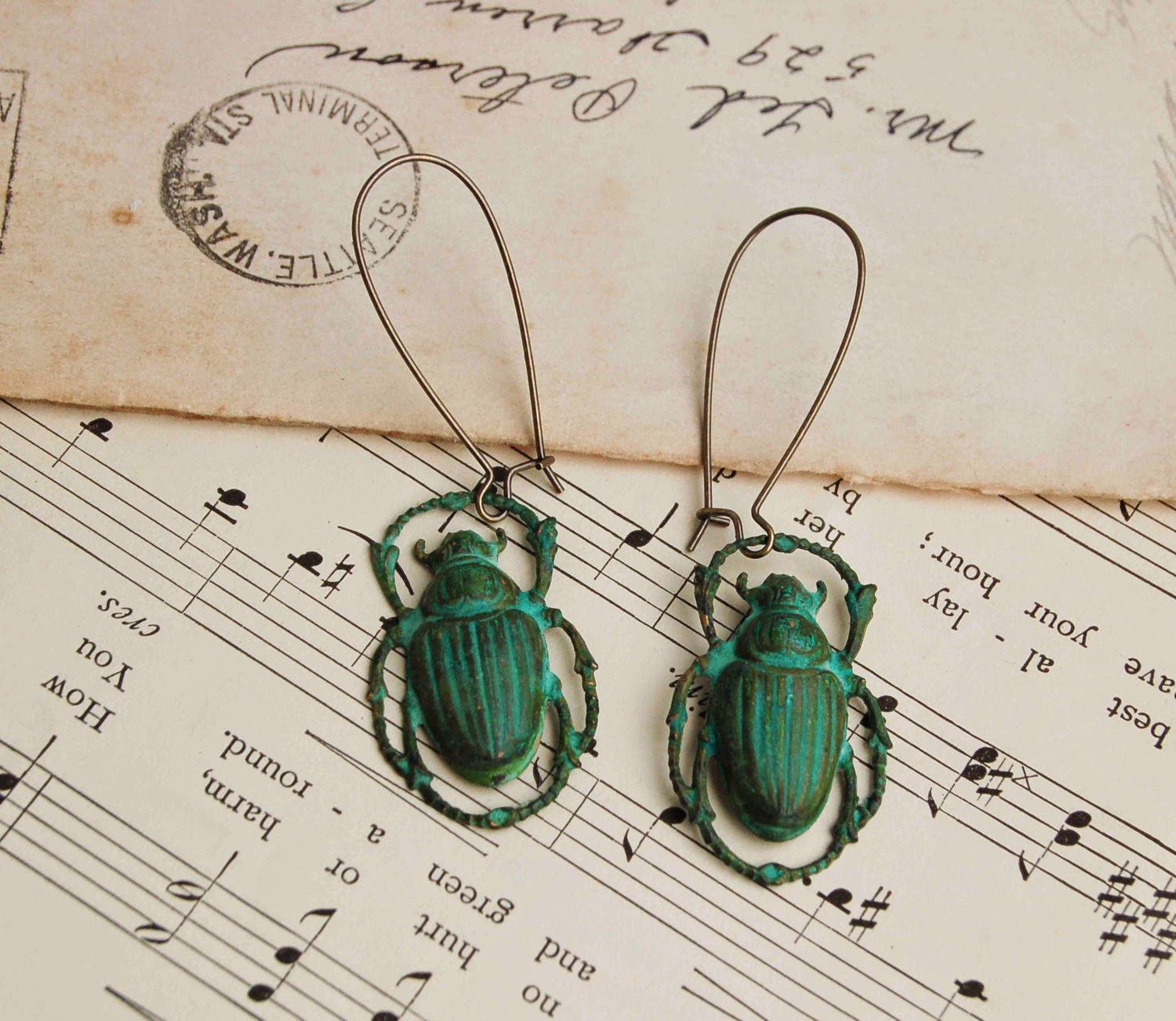 https://www.etsy.com/listing/89823023/steam-punk-green-beetle-earrings?ref=shop_home_active_5&ga_search_query=beetle