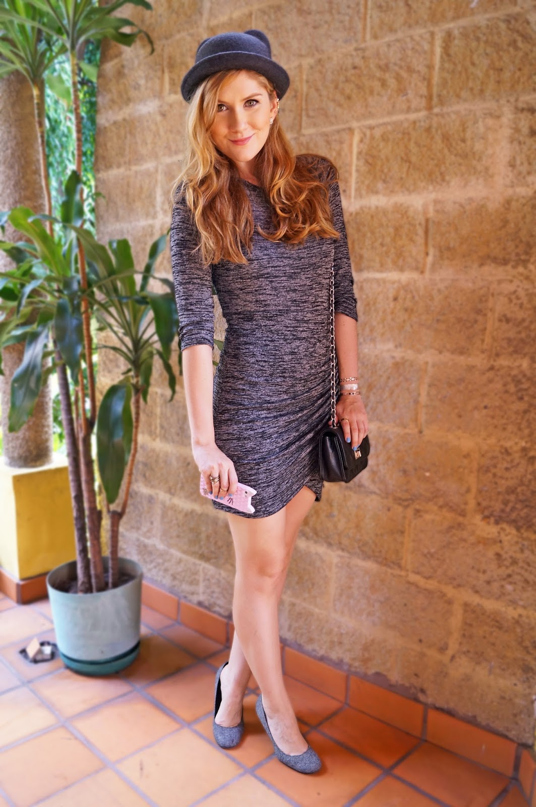 A great way to wear a fun hat is pairing it with a simple sweater dress. So chic!