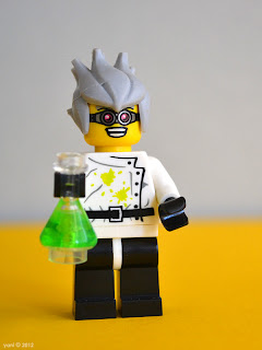 lego mad scientist mixes up a batch of something green and glowing