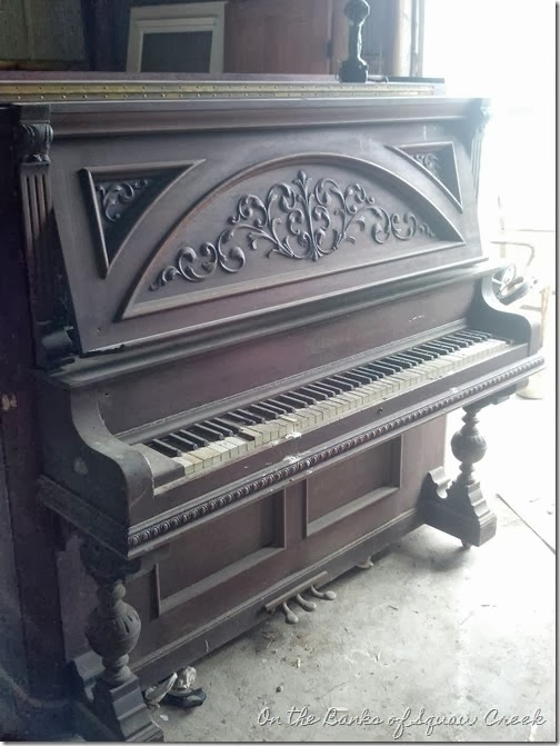 The before of a wood carved piano / Stylin' repurposed upright piano desk, by On the Banks of Squaw Creek, featured onhttp://www.ilovethatjunk.com