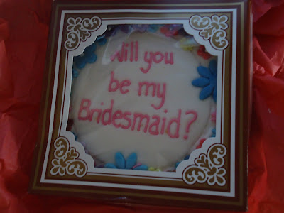 Emma asked me a question on a cookie. She asked Will you be my bridesmaid?