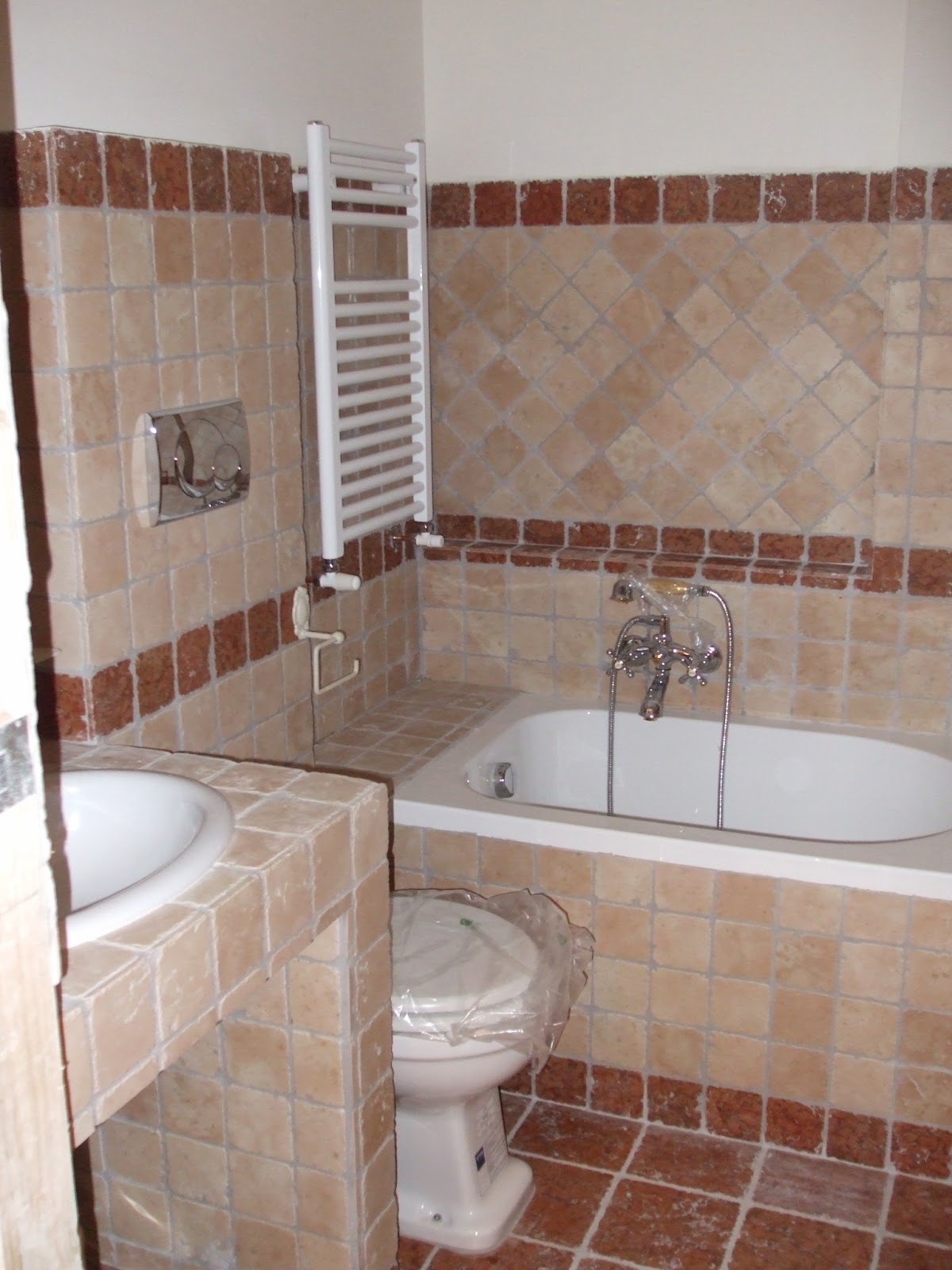 Edilizia roma ristrutturazioni edilizia ro ma s n c for Arredo bagno in muratura