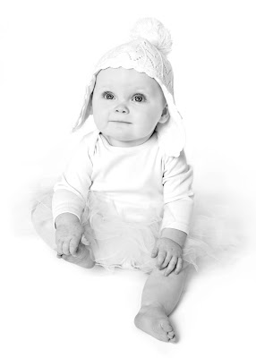 cute baby with white hat, portrait by photographer, baby photos