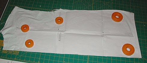 Next, fold the back of the tee in half vertically and place the back