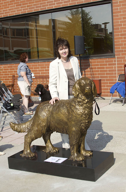 Bronze dog sculptor Lena Toritch with custom bronze dog portrait statue