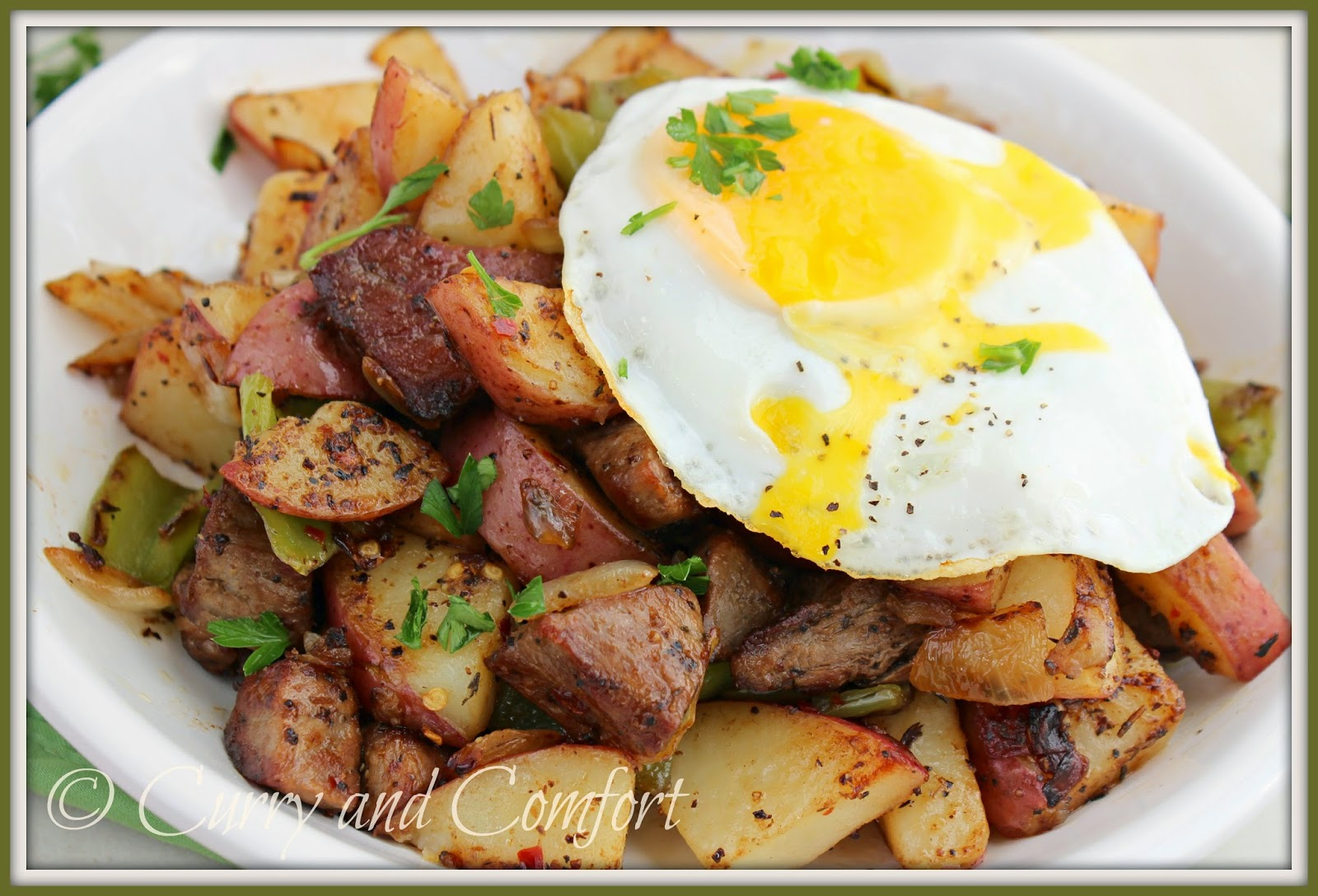 Curry and Comfort: Steak and Potato Hash Topped with a Fried Egg