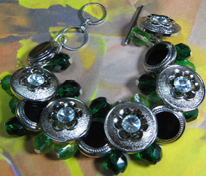 Glamorous bracelet has silver flower buttons mixed with clusters of shiny green beads
