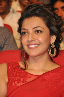 Actress Kajal Agarwal Latest Pictures in Red Saree at Govindudu Andarivadele Movie Audio Launch  014