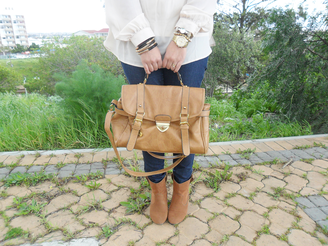 ankle boots, cream blouse, satchel, gold arm candy, gold watch