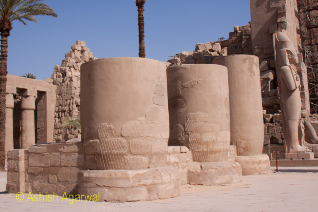 A row of pillars that seem to have been cut in half inside the Karnak temple in Luxor