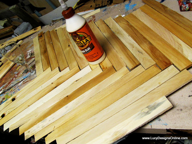 wood shims in herringbone pattern for butterfly wall art