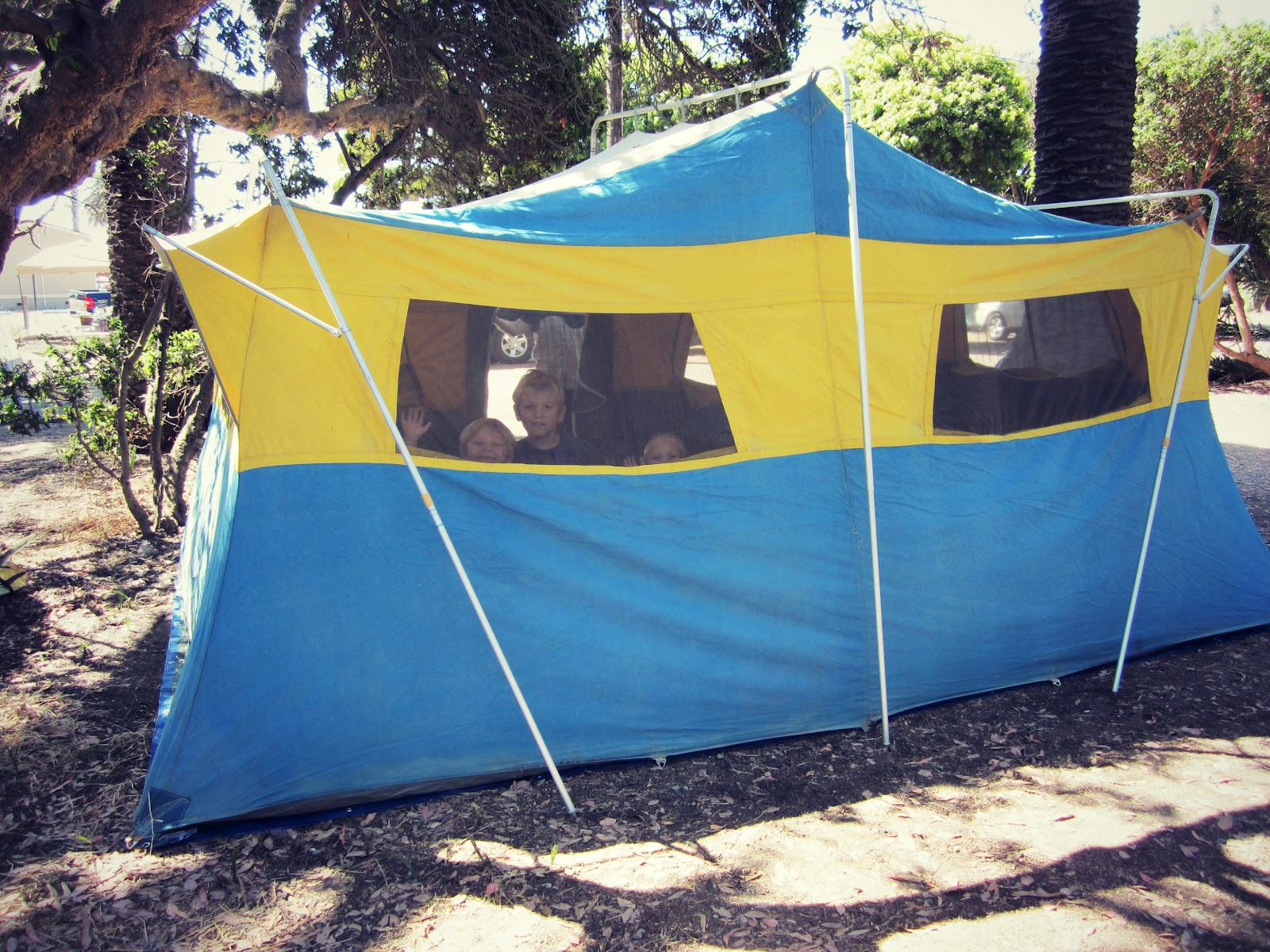 The kids raced inside to check it out. & Picnics in the Park: Meet Our Vintage Canvas Tent
