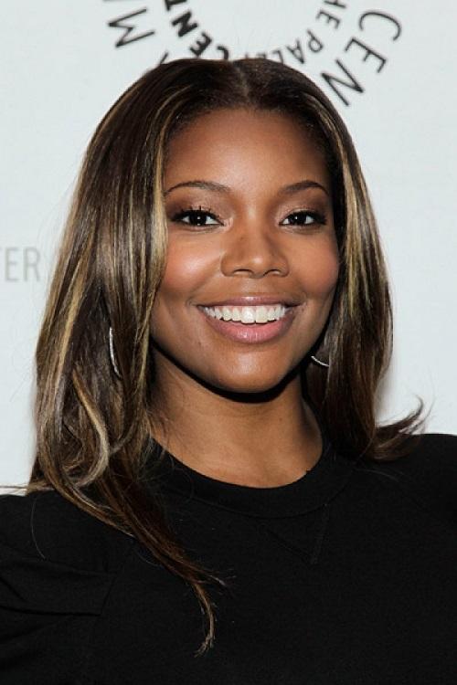 Dark black women with brown hair
