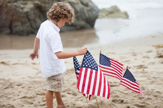 Image credit: <a href='http://www.123rf.com/photo_20149245_cute-boy-with-american-flags-on-the-beach-in-malibu-california.html'>awesomeshotz / 123RF Stock Photo</a>