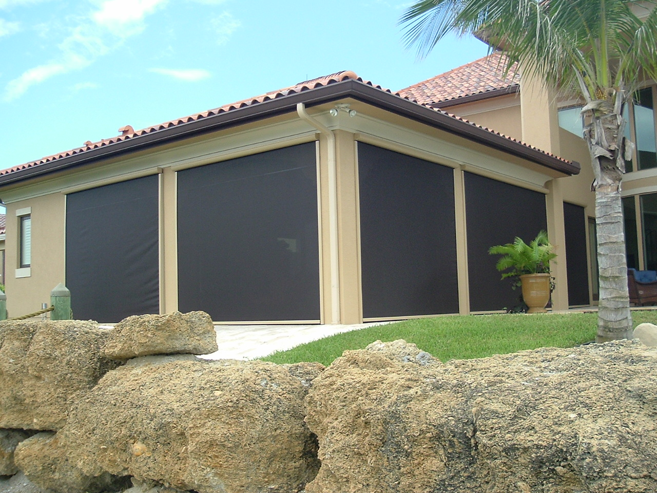 With Motorized, Retractable Patio Shades