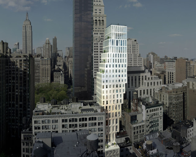 Photo of the building as seen from the air with other NYC buildings around