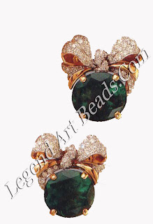 A pair of emerald and diamond bowknot earclips