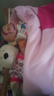 dolls in snuggle sac