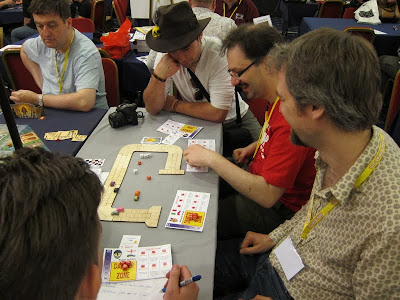 Zoom Zoom Kaboom - Andy Hopwood (the designer bottom right) demonstrating his latest game