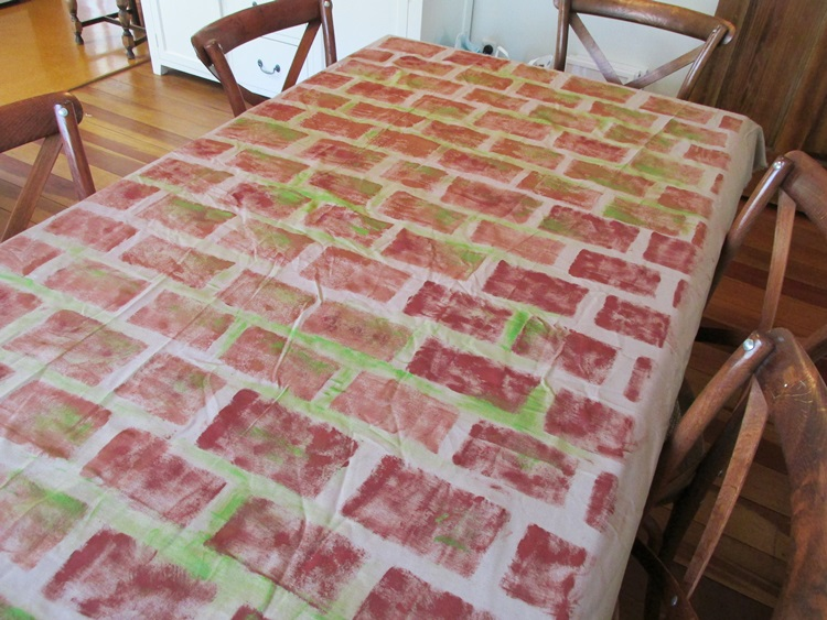 Brick stencilled table cover (mossy)