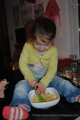 toddler mashing bananas for cake