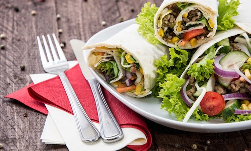Healthy wraps filled with vegetables on a plate