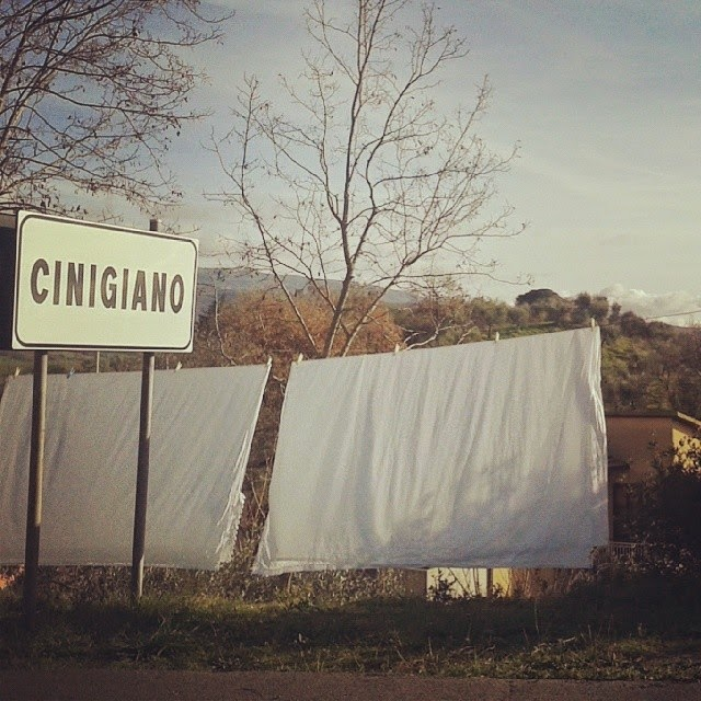 A washinline and Cinigiano road sign at the end of the village
