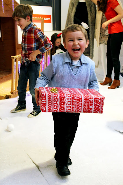 A delighted Big Boy getting a gift from Santa