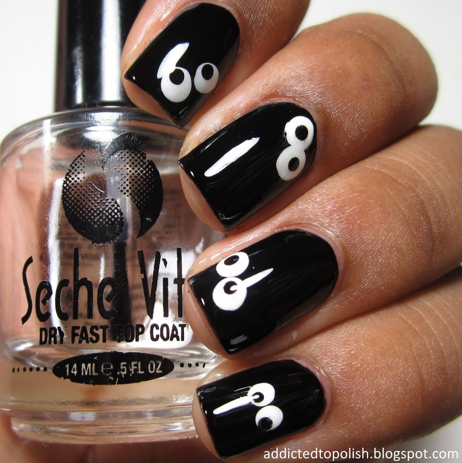 spooky-eyes-in-the-dark-halloween-nail-art
