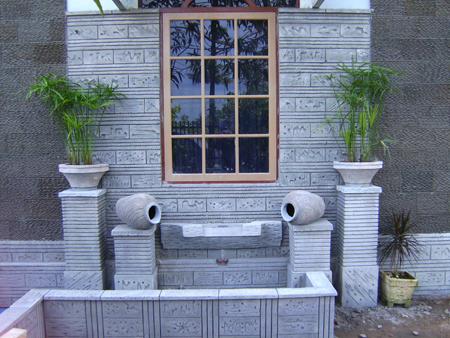 desain dinding luar rumah